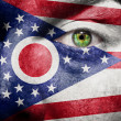 Flag painted on face with green eye to show Ohio support — Stock Photo