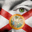 Flag painted on face with green eye to show Florida support — Stock Photo