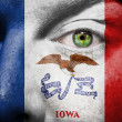 Flag painted on face with green eye to show Iowa support — Stock Photo