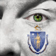 Flag painted on face with green eye to show Massachusetts suppor — Stock Photo