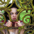 Royalty-Free Stock Photo: Scared woman locked behind a gate