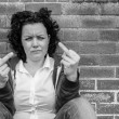 Young woman showing two middle fingers — Stock Photo