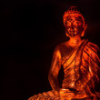 Gautama Buddha in warm light - Stock Photo