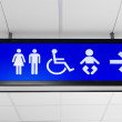 Blue public sign showing toilet directions — Stock Photo