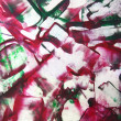 Abstract hand drawn paint background: red and green floral patterns — Stock fotografie