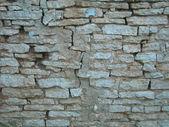 Old, ragged brick wall texture — Stock Photo