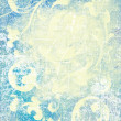Abstract textured background: white flower-like patterns on blue backdrop — 图库照片