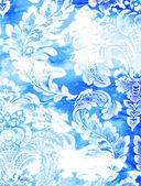 Abstract textured background: white floral patterns on blue backdrop — Stock Photo