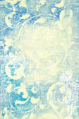 Abstract textured background: white flower-like patterns on blue backdrop — Stock Photo