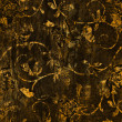 Abstract textured background: yellow gold floral patterns on dark brown backdrop — Stock Photo #15879339