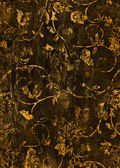 Abstract textured background: yellow gold floral patterns on dark brown backdrop — Stock Photo