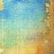 Old canvas: abstract textured background with blue, yellow, and brown patterns — ストック写真
