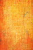 Old canvas: Abstract textured background with red and orange patterns on yellow backdrop — Stockfoto