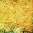 Old ragged wall: Abstract textured background with red, brown, and green patterns on yellow backdrop — Stock Photo #16629479