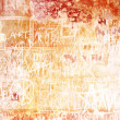 Stock Photo: Old inscribed wall: Abstract textured background with red and brown patterns on white backdrop
