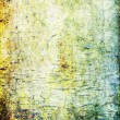 Stock Photo: Old ragged wall: Abstract textured background: blue, brown, and green patterns on yellow backdrop