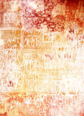 Old inscribed wall: Abstract textured background with red and brown patterns on white backdrop — Stock Photo