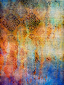 Old fabric: Abstract textured background with blue, yellow, and red patterns — Stock Photo