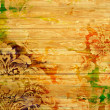 Old wooden wall: Abstract textured background with red, yellow, and green patterns - Stock Photo