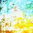 Abstract textured background with yellow, blue, and orange patterns on white backdrop — Foto Stock #17458837