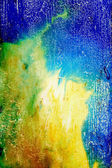 Abstract textured background with green, yellow, and brown patterns on blue backdrop — Stock Photo