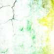 Stock Photo: Old shabby wall: Abstract textured background with green, yellow, and brown patterns on white backdrop