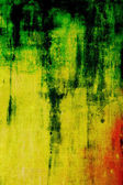 старый холст: абстрактный текстурированный фон с зеленым и красным рисунком на желтый фон — Стоковое фото