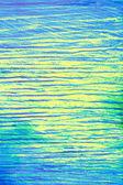 Texturou pozadí abstraktní s paralelní modré čáry na žlutém pozadí — Stock fotografie