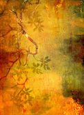 Abstract textured background with red, green, and brown floral patterns on yellow backdrop — Stock Photo