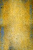 Abstrakt texturerat bakgrund med blå och brun mönster på gul bakgrund — Stockfoto