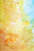 Abstract textured watercolor background with blue, white, and brown patterns on yellow backdrop — Stock Photo