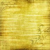 Fondo amarillo abstracto o papel con focos brillantes con textura de fondo grunge y bambú marrón paterns — Foto de Stock