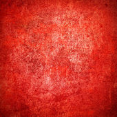 Abstract red background or paper with bright center spotlight and dark border frame with grunge background texture — Stock Photo