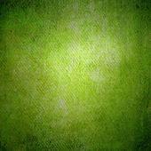 Fondo verde abstracto o papel con spotlight centro brillante y oscuro border marco con textura de fondo grunge. para el diseño vintage de luz colorido arte gráfico — Foto de Stock