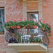 Stock Photo: Balcony with flowers.