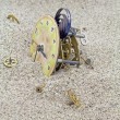 Old mechanical watch on the sand. — Stock Photo