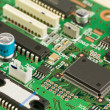 Stock Photo: Green circuit board with components.