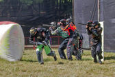 Paintball. Athletes in a protective manner. — Stock Photo