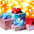 Royalty-Free Stock Photo: A couple of presents tied with a blue and red bows