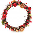 A seasonal wreath decorated with a dried oranges and floral details - Стоковая фотография