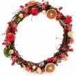 A seasonal wreath decorated with a dried oranges and floral details - Foto Stock