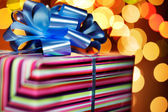 A present tied with a blue bow — Stock Photo