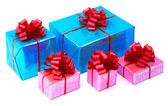 A pink and turquoise blue presents tied with red bows — Foto Stock