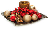A seasonal decoration with a candle — Stock Photo
