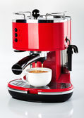 A red vintage looking espresso coffee machine is making a coffee — Stok fotoğraf