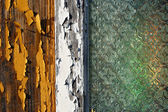 An old wooden house window with pealing off paint and old decorated window glass — Stock Photo