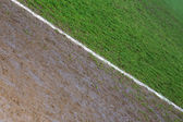 Border line of a football field photographed on a rainy day — Stock Photo