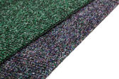 A gray and green carpets — Stock Photo
