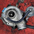 Постер, плакат: Old worn out turbocharger of a turbo diesel engine