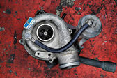 Old worn out turbocharger of a turbo diesel engine — Stock Photo